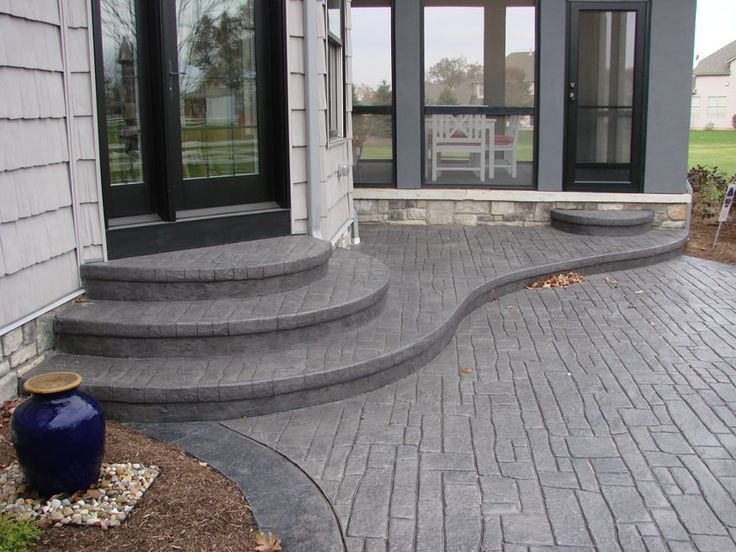 i like the idea of rounded stairs coming from our patio door stamped concrete patio ideasbackyard - Stamped Concrete Design Ideas