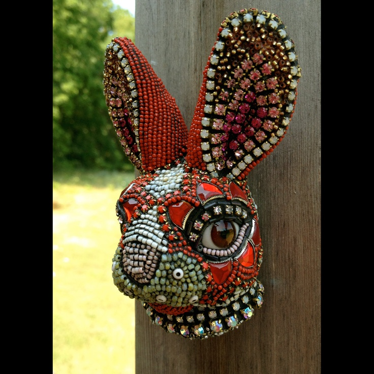 4 inches tall and 3 inches wide and 2 inched deep Bunny Three is a wall hanging rabbit head. This brown-eyed boy is covered in glass beads and vintage glass stones using a mosaic process. Bunny Three's eyes are discarded glass doll eyes from the grounds of old pre WW2 doll factories in Germany. I am currently doing a series of bunny heads with each form being unique in shape and surface design.