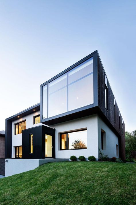 Connaught Residence is contemporary renovation and addition of a family home  designed by NatureHumaine, situated in Notre Dame de Grce, Montreal,  Quebec.