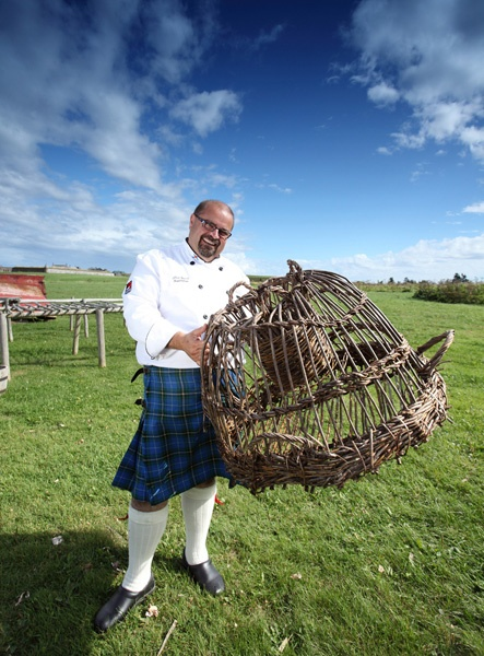 The Kilted Chef holding 18th century lobster trap
