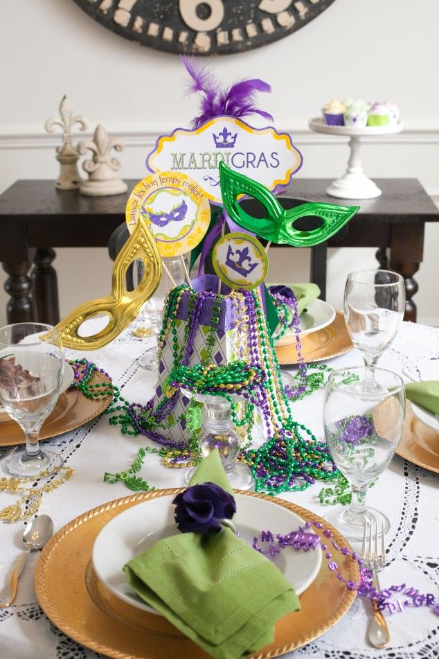 Set a festive table to celebrate Mardi Gras! Gold chargers, beads and a  few masks add perfect flair.