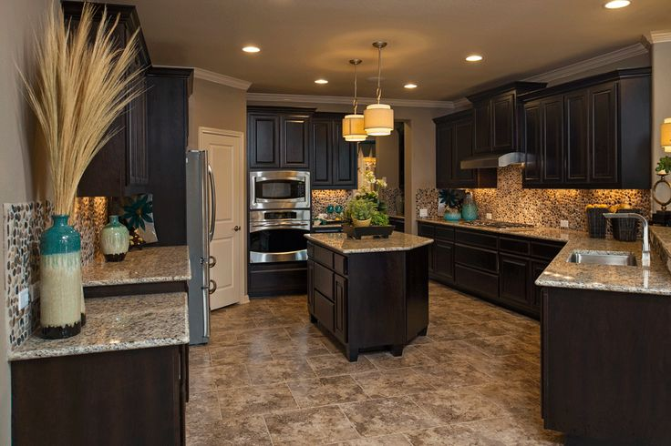 Kitchen layout. I like the colours because it's not too dark and dungy looking. The light colours really compliment the dark cabinets.