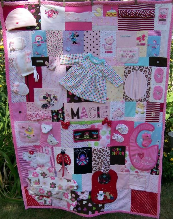 I like this take on the baby clothes memory quilt. I love that it's so busy! :)