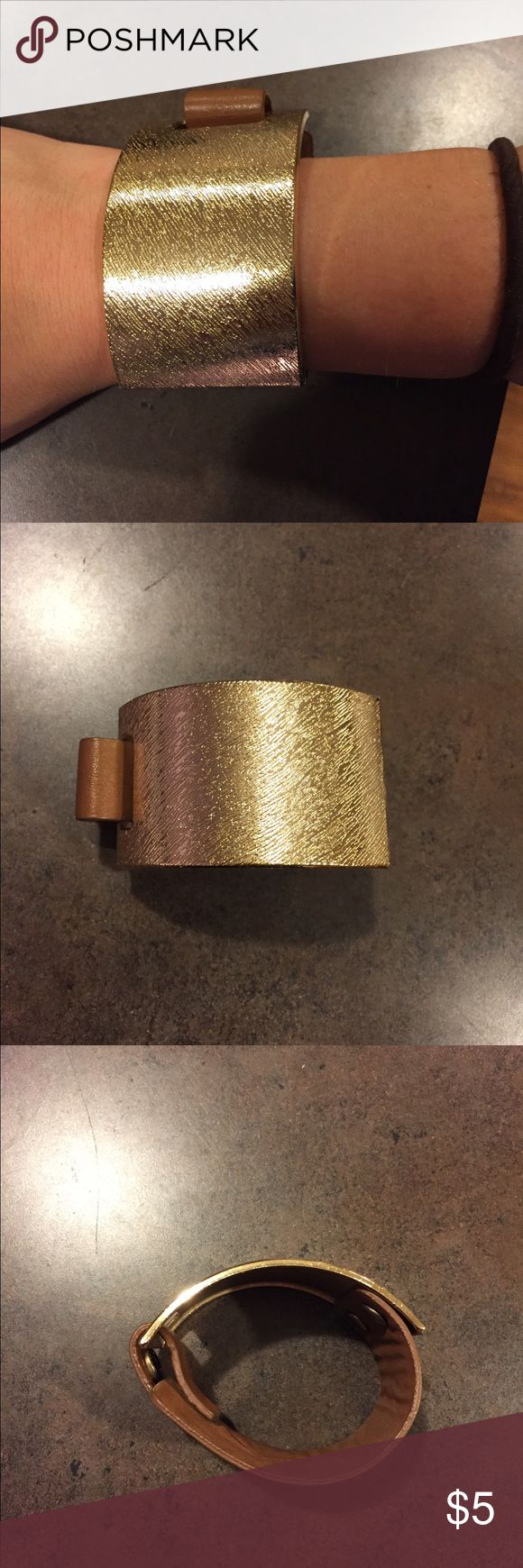 Leather/gold cuff bracelet. The contrast of the gold and leather is fun to match with whatever! Adjustment snap application to fit whatever size wrist. target Jewelry Bracelets