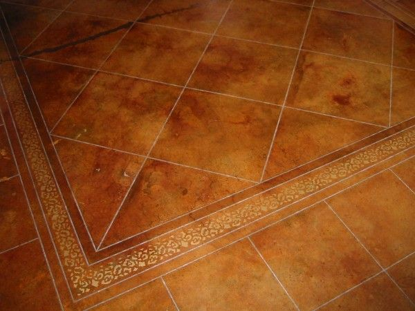 Acid Etched Concrete Stain is used throught out our home. This would be good in our basement!!
