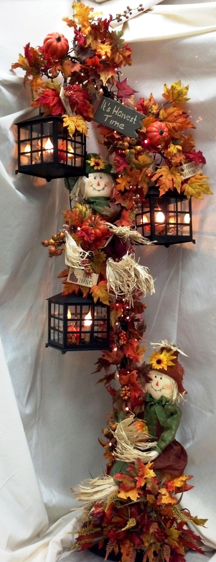 Fall Lanterns decorated with burlap and scarecrows! :)  Love it!! #fall #benfranklinonline
