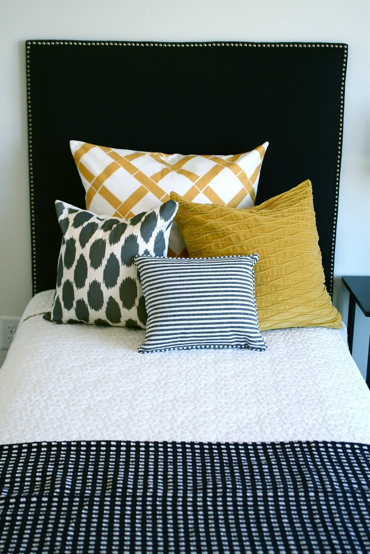 navy and mustard and textured quilts. love this pillow arrangement