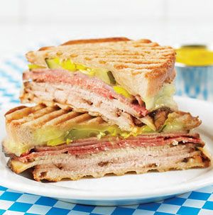The Florida Cubano sandwich is almost the perfect sandwich! Roast pork, salami and deli ham with pickles and banana peppers on hearty Vienna bread. It's downright addicting. from Seasons.