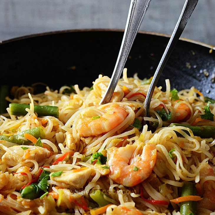 Rice Noodles with Chicken and Prawns Recipe Main Dishes with vegetable oil, onions, garlic, bell pepper, carrots, beans, shredded cabbage, chicken stock, rice noodles, ginger, cayenne pepper, soy sauce, oyster sauce, sesame oil, chicken breasts, prawns