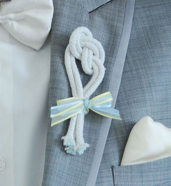 Tie the Knot Boutonniere There are lots of knot ideas - one over the couples hands, a celtic tradition,  and another where the guests tie strings around each of you as they convey their good wishes.     There are beautiful intricate celtic knots.