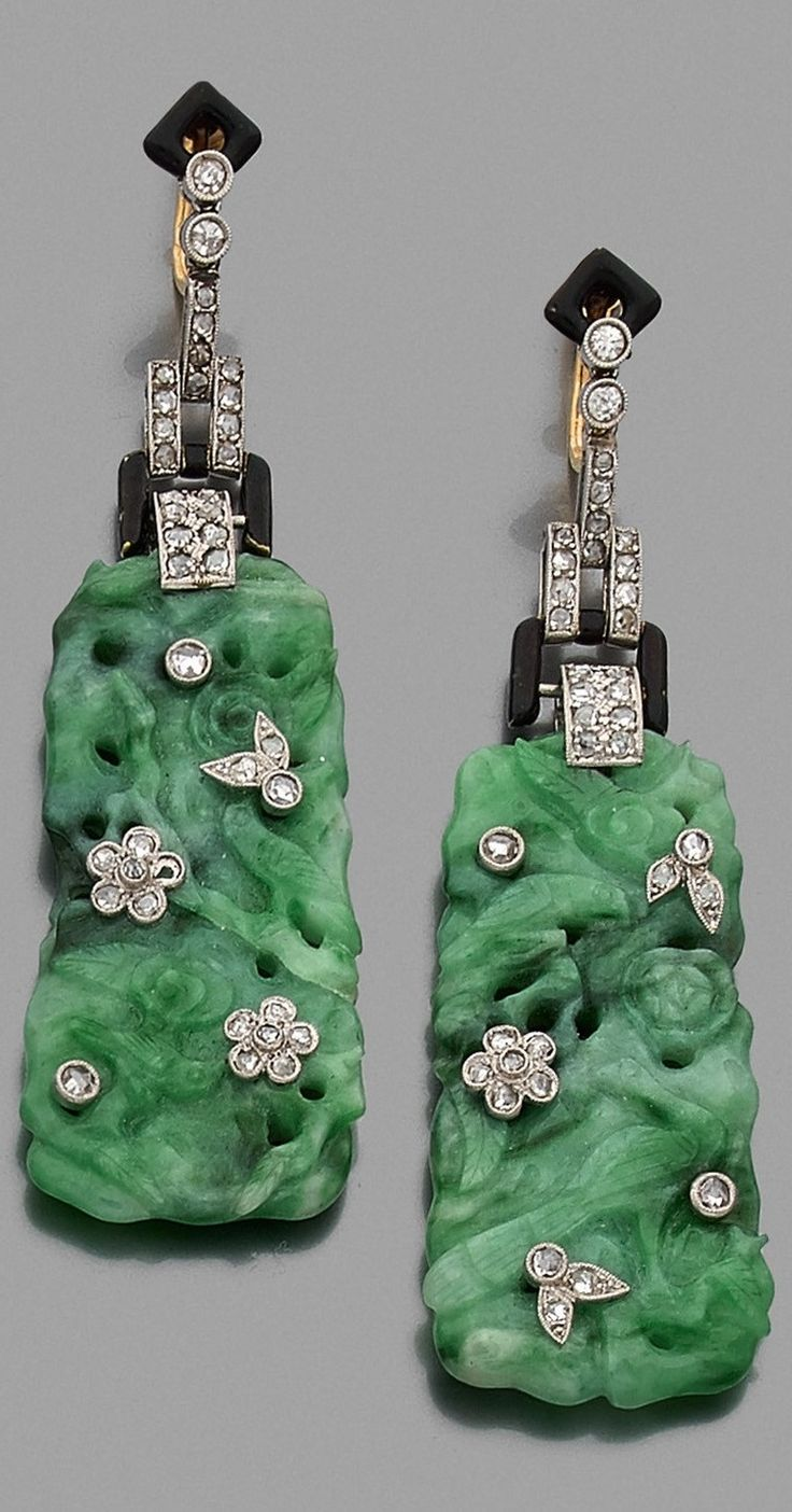 A rare pair of Art Deco platinum, gold, enamel, jade and diamond ear pendants, circa 1925. Length 7cm. #ArtDeco #earrings