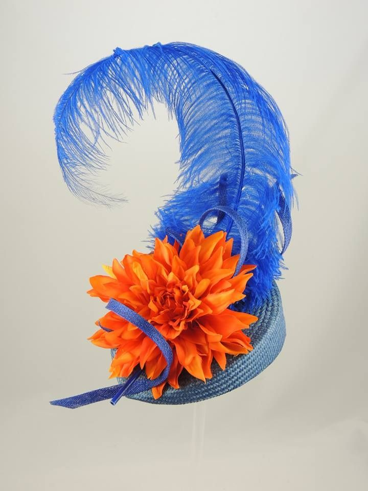 Royal blue straw headpiece with full ostrich feather and orange flower