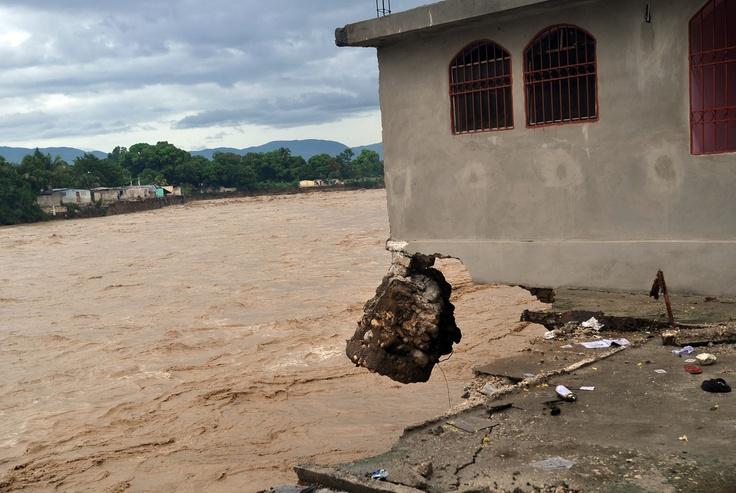 A house is destroyed by heavy flooding from Hurricane Sandy October 25, 2012 in Port-au-Prince, Haiti.