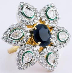 Hand-crafted designer ring finely studded with centre piece gemstone and cubic zirconia (American diamond) stones
