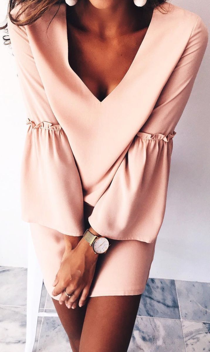 Blush dress with bell sleeves.