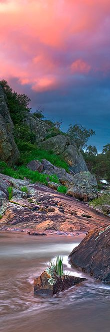 A vertical panorama of a cotton candy colored sunset at Serpentine falls in Western Australia