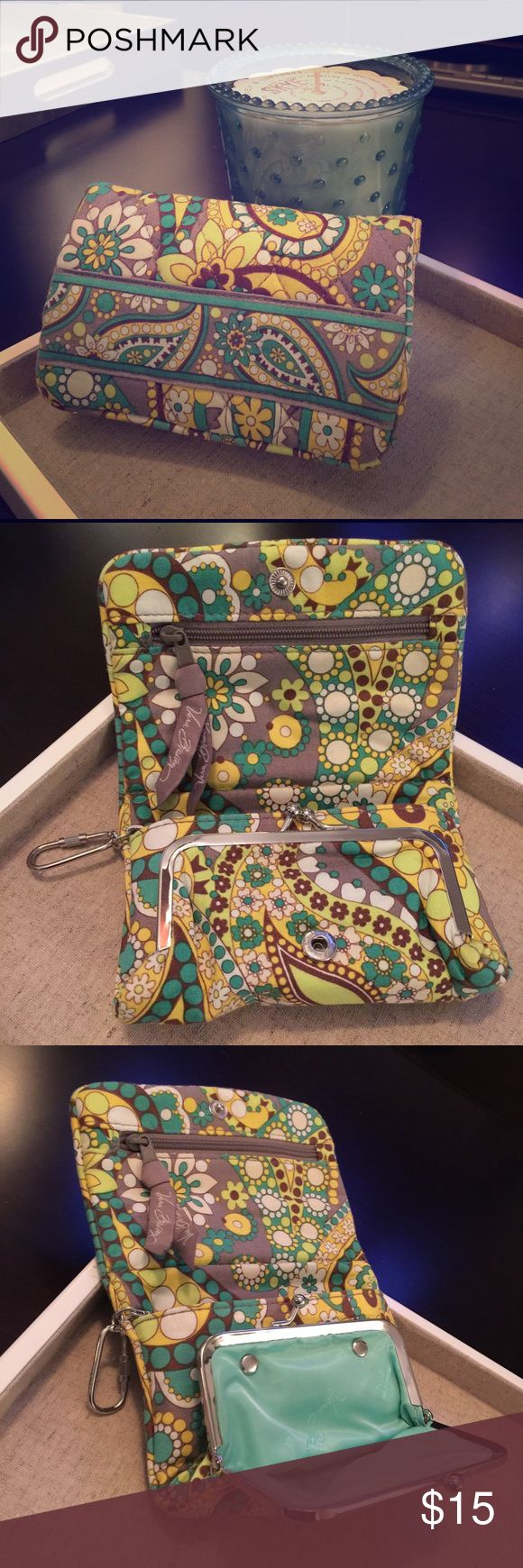 Vera Bradley paisley wallet This adorable paisley wallet by Vera Bradley has one zipper pocket and a clasped pocket in addition to the main pouch. On the outside, there is a clear sleeve for an ID card. Colors include a turquoise blue, bright green, golden yellow, brown and gray. This item has rarely been used and is in great/like-new condition. Vera Bradley Bags Wallets