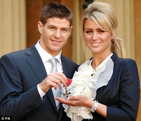 Steven Gerrard, Liverpool captain, and his wife Alex Curran outside Buckingham Palace, London, after he collected an MBE from Britain's Quee...