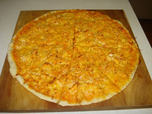 The Best Buffalo Chicken Pizza Recipe: Would have never thought to use ranch dressing as a base for the sauce but it was sooo tasty! I used Tyson's Grilled & Ready Chicken and Sweet Baby Ray's Buffalo Wing Sauce. This is my new favorite homemade pizza!