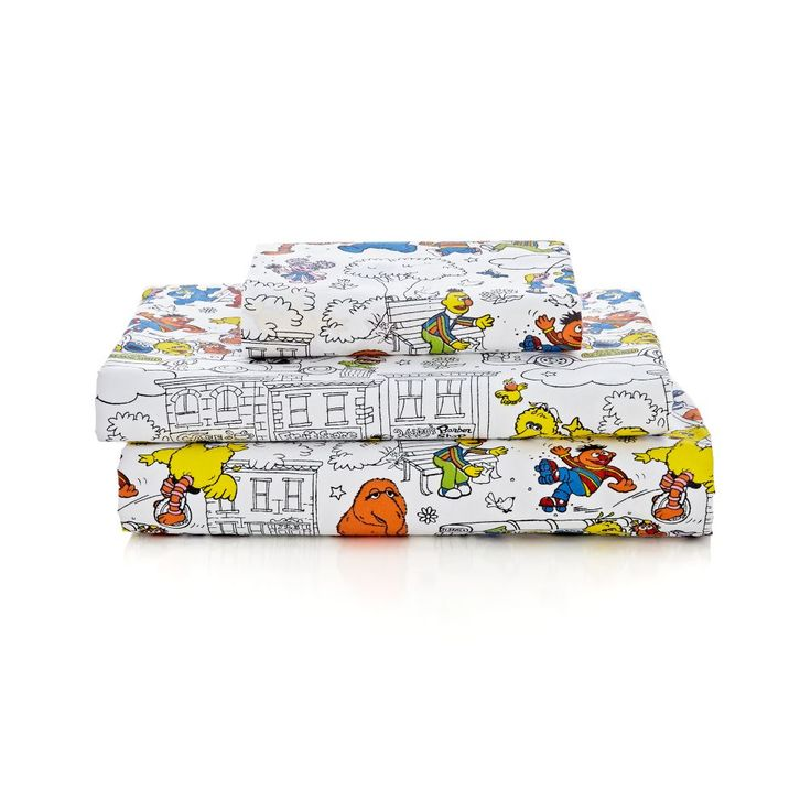 Shop Sesame Street Organic Twin Sheet Set.  Black and white with bright dashes of color throughout, the exclusive print on our Sesame Street Sheet Set includes all your favorite characters in a lively scene.