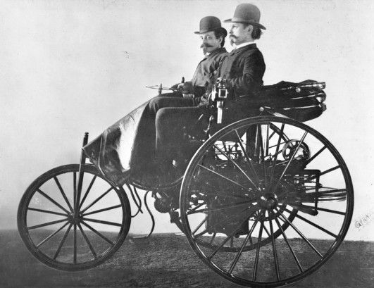 Karl Benz (Foreground) Sits Proudly on Top of his Invention - The World's First Car, 1885