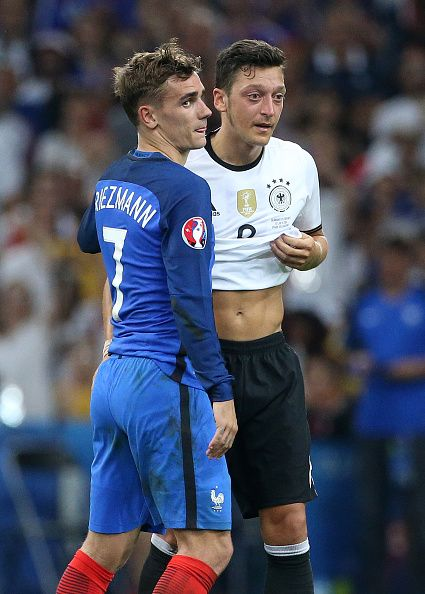 #EURO2016 Antoine Griezmann of France greets Mesut Oezil of Germany following the UEFA Euro 2016 semifinal match between Germany and France at Stade Velodrome...