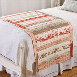 "Easy pattern made with jellyroll strips! To make a fast simple ""quilt as you go...the middle one is jelly roll...just put down your fabric backing, batting and then start at the top with your first strip and cont. down;  add binding and  Voila you have your Bed runner."
