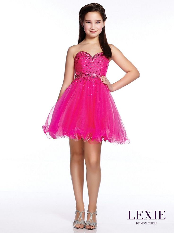 The Lexie by Mon Cheri TW21531 junior party dress has a vivacious A-line silhouette that finishes with a cocktail-length skirt. Scattered crystal beadwork decorates the strapless bodice and the top skirt, gently emphasizing the sweetheart neckline and the natural waist. The multi-layered tulle skirt flutters luxuriously with a curly hemline.