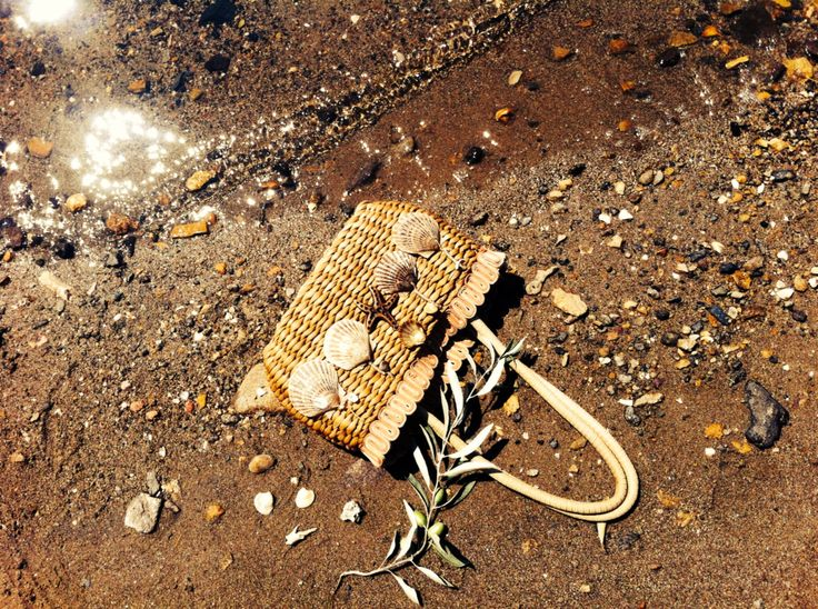 A bag with seashell # olive branch # on the beahc #