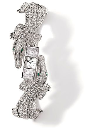 Cartier's 18k white gold, diamond and emerald baby crocodile watch