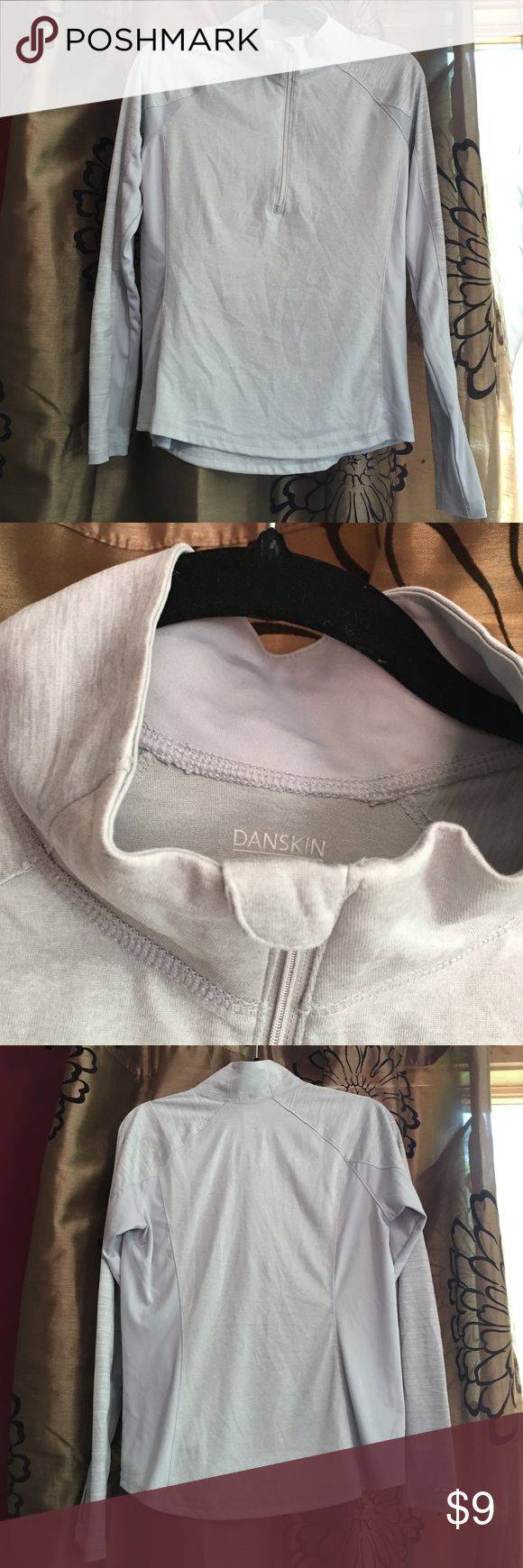 Danskin pullover top Gray/ silver danskin under layer. Great for fall weather. Worn once with zero signs of any wear. 3/4 zip. Chin protection from the zipper if worn under ski or snow mobile clothing. Demi fitted. Danskin Tops