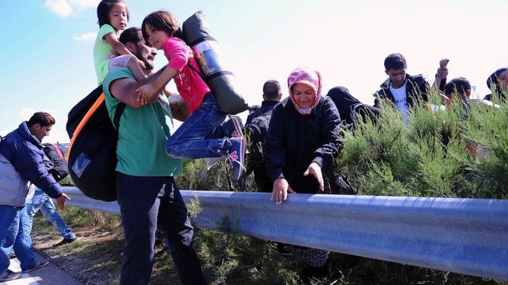 """The European Commission president urges EU nations to accept their share of 120,000 extra refugees, saying it is """"time for concerted action""""."""
