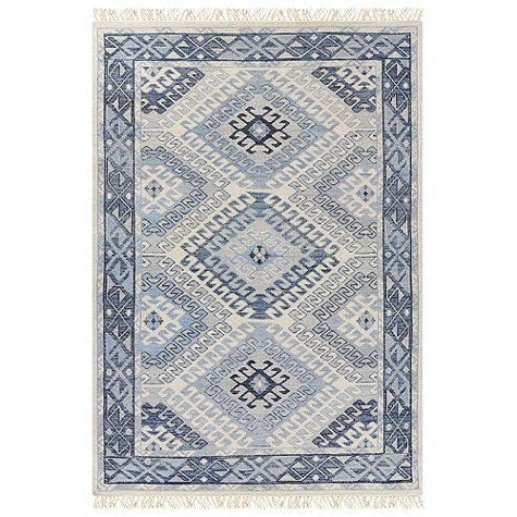 A stunning use of color in three sophisticated shades of blue updates this traditional tribal design, making it a great choice for any home. The repeating, large-scale geometric motif is hand knotted from 100% wool. Use of a rug pad is recommended.Lindley Hand Knotted Rug features:Versatile design works in a variety of interiorsPattern scale & repeat will vary with rug sizeFringed on both endsSizes are approximateImported