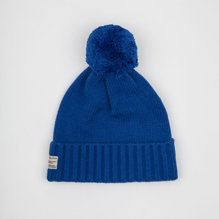 RVLT - men's fashion. Blue acrylic beanie knit with tassel.