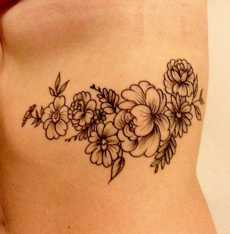 Floral rib tattoo                                                                                                                                                      More