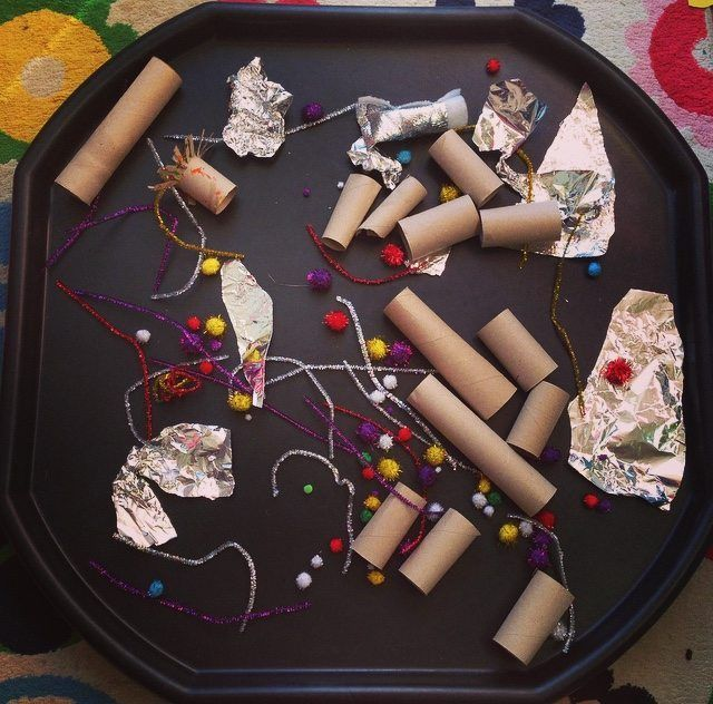 This simple loose parts play was a last minute idea that I put together when I found a stash of sparkly pipe cleaners and pom poms whilst trying to dig out something else from my art supplies. As it's bonfire night tonight I though they would...