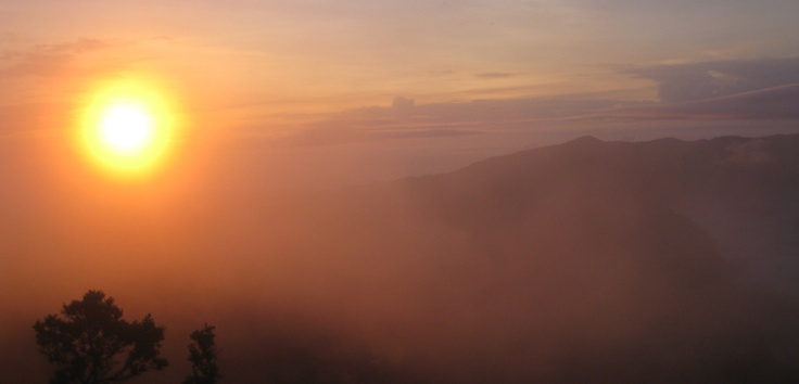 As the gold bright sun slowly rises, piercing through the morning haze over Mount Bromo, it ascends to light up and warm the earth. Photo by Andika Saputra - http://www.indonesia.travel