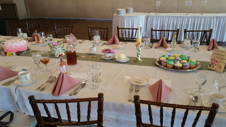 Alice in Wonderland Baby Shower at Avalon Manor! Dusty Rose napkins and Sage table runners accented the vintage, eclectic table decorations.