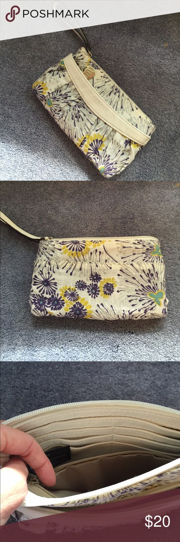 COLORFUL PURPLE CLUTCH EUC This colorful pretty clutch has lots of compartments and slots for 6 cards. 2 zipper compartments and a slot for bills and a back slot. Fabulously fashionable! Elle Bags Clutches & Wristlets