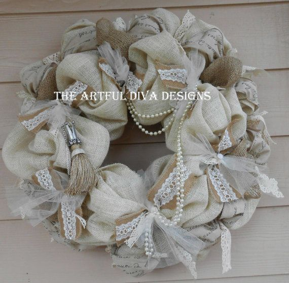 Elegant and sophisticated with a bit of whimsy. This wreath is a cream burlap base with jute burlap tucked in all around. it features french