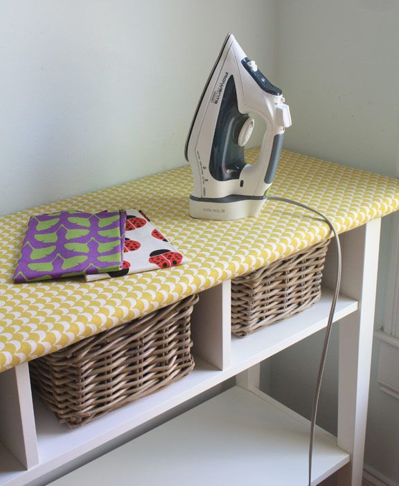 This clever IKEA hack turns the top of a long table into an ironing space, and offers spots for baskets underneath.