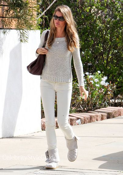 Seen on Celebrity Style Guide: Supermodel Gisele Bundchen wore these white skinny jeans and knit boots leaving a friends house in Santa Monica, California on February 2, 2014.
