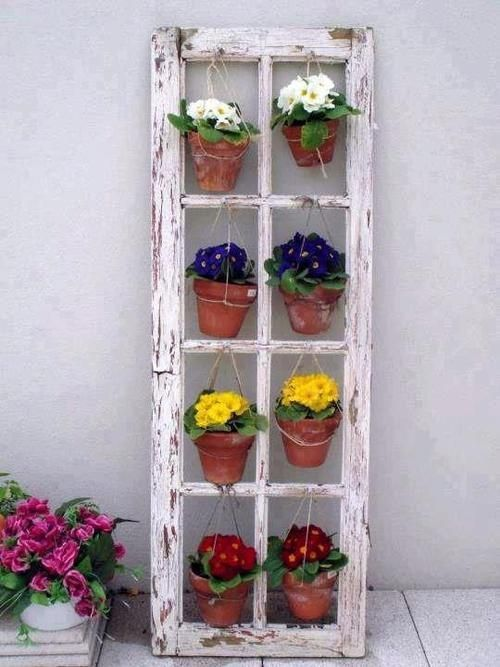 Clever idea: an old window frame to hang flower pots from. There are loads of ideas for old window frames and even old doors.