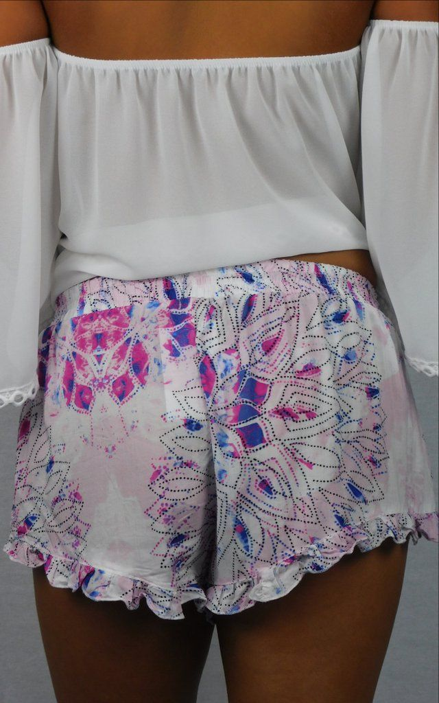 Our Bermuda Sand Shorts are a multi-color of pink, blue, white and black with a tulip-front overlap and ruffled hem. Elastic waistband and a drawstring with pin