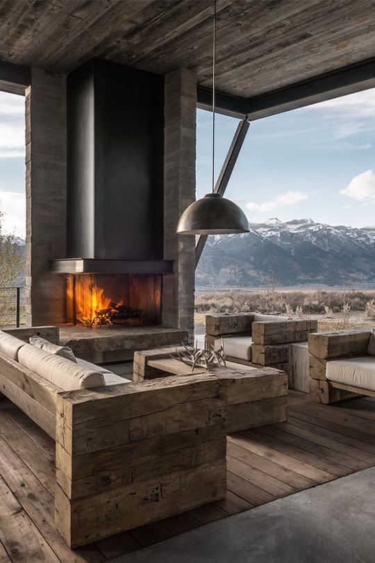 Outdoor Living Spaces with Cozy Fireplace design with Natural Wood Furnishes. #outdoor