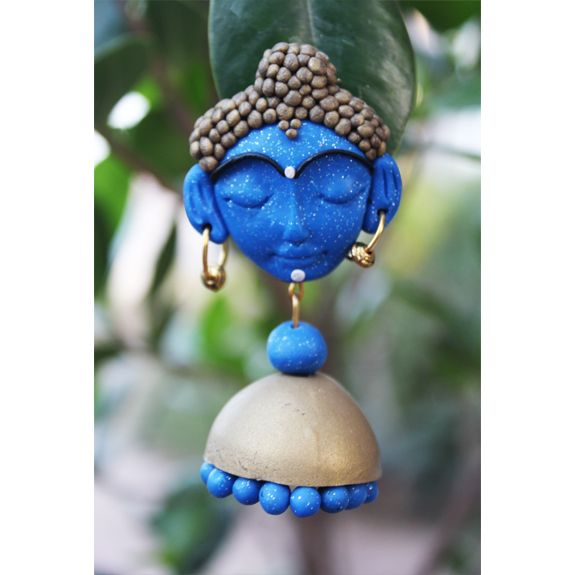 The possibilities of creative ideas are endless when it comes to Polymer Clay and we present to you, our collection of skillfully crafted ethnic jewelry designs, which are inspired by divinity Care - Store in zip lock pouches and clean with soft cotton when required  Dimension: L:7 cm, B: 3 cm Weight: 16 gm Color: Glitter Blue and Antique Gold Material: Polymer clay Closure: Matellic & post Finish: Hand crafted