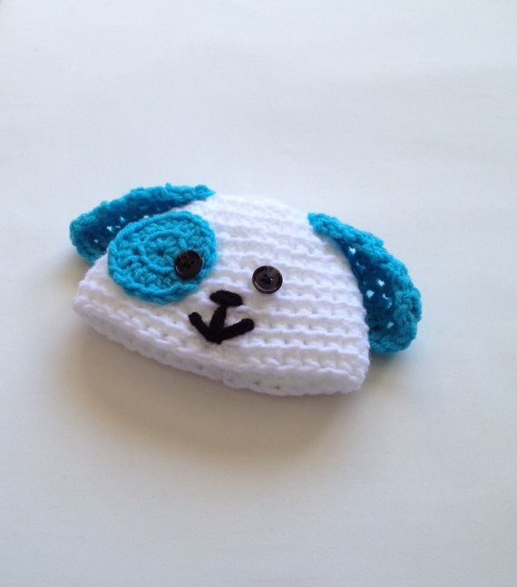 $9.00 - White and sky blue crochet dog beanie hat, size Newborn 0-3 Months. This is a sweet, simple design of hat that is great for your little boy! Also makes a great gift!