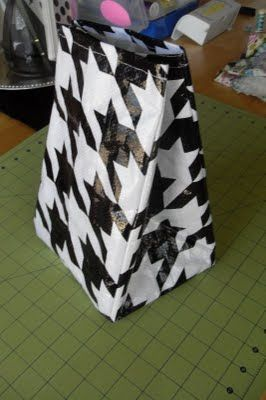 Vinyl lunch bags:  I love the idea of using a reusable shopping bag!!!