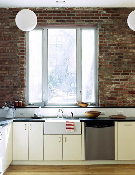 Brick wall kitchen with a view.
