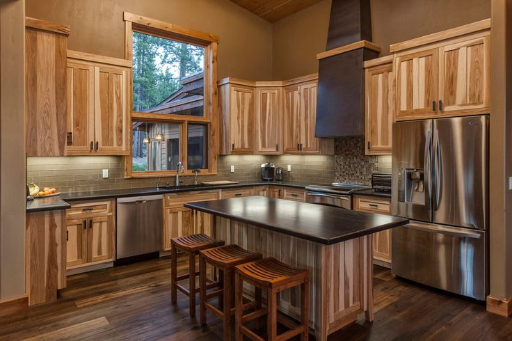 rustic hickory kitchen cabinets Kitchen Contemporary with black countertop brown mosaic